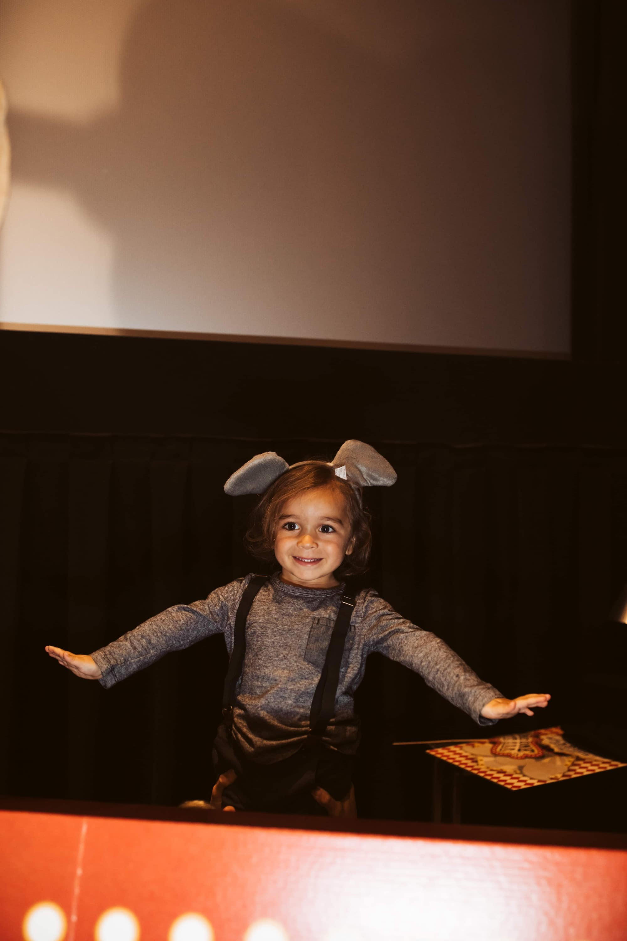 kid playing theater