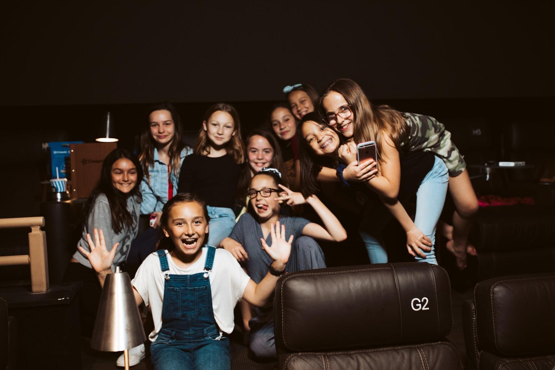 girls at movie theater