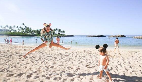 kids on the beach at disney aulani