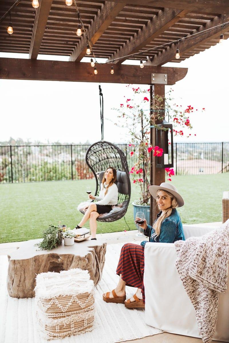 women sitting on patio