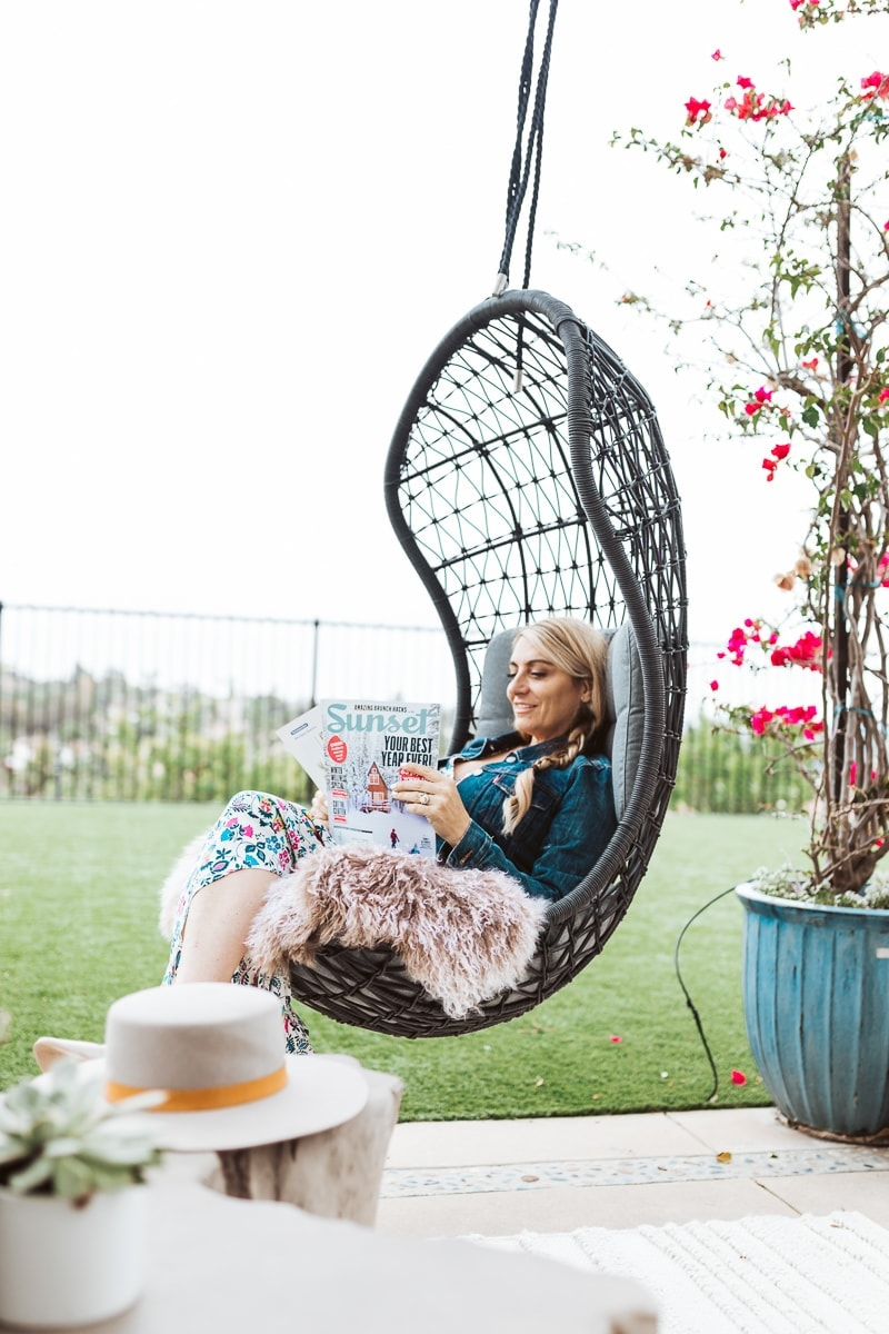 woman sitting in swing chair