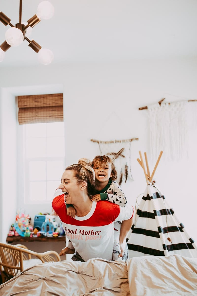 mother and child laughing