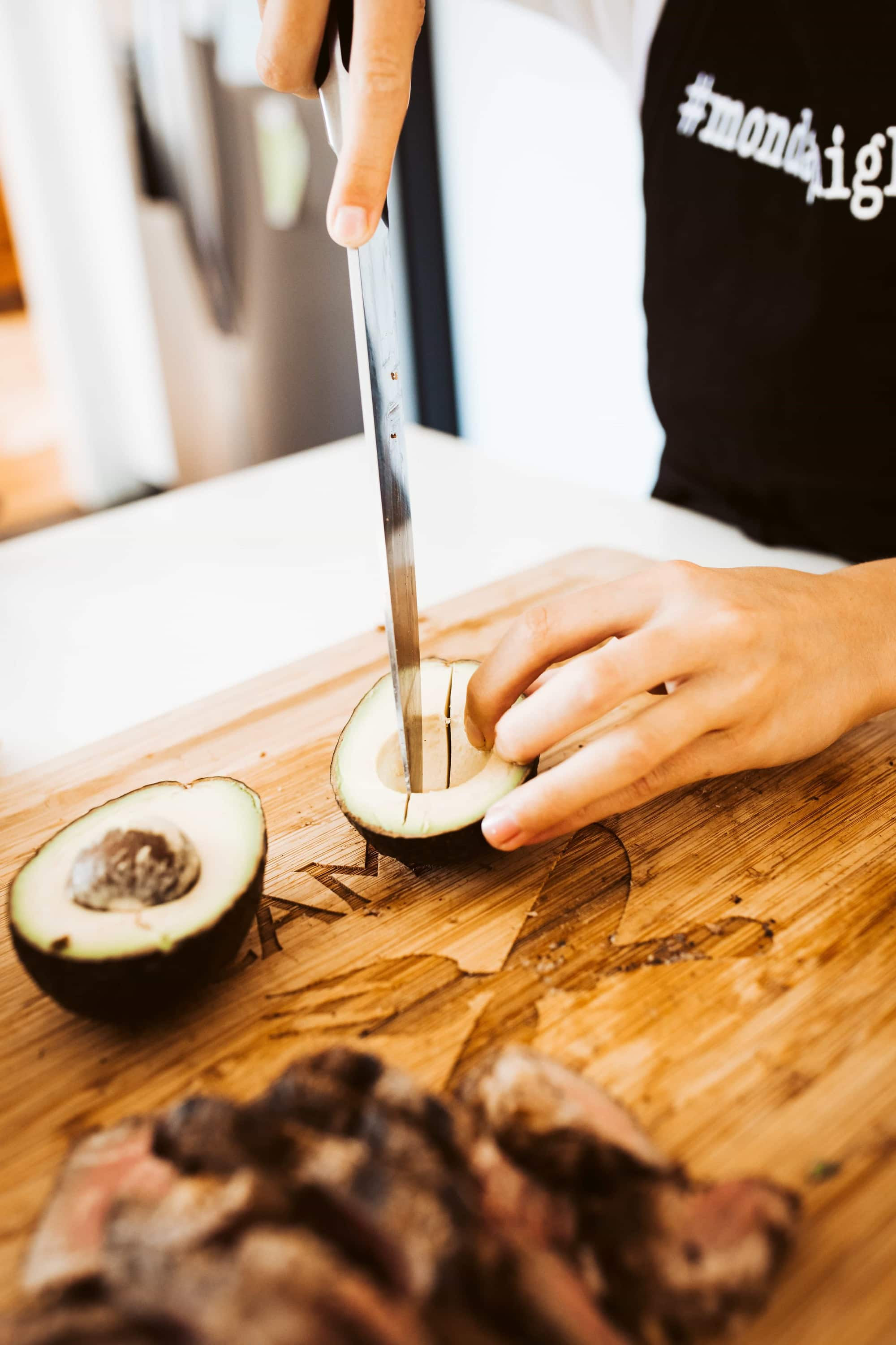 chef slicing avocado