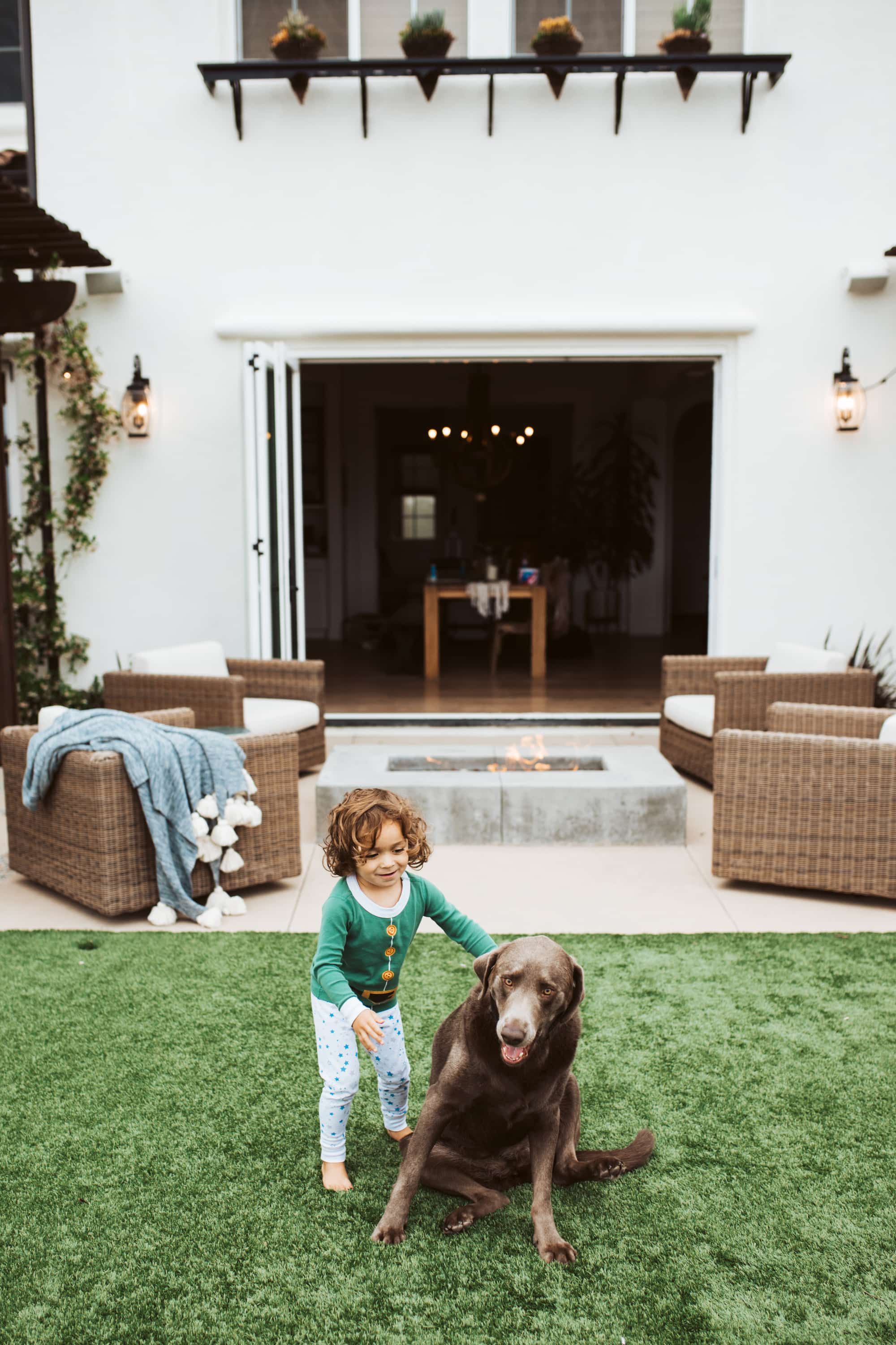 boy and his dog in backyard
