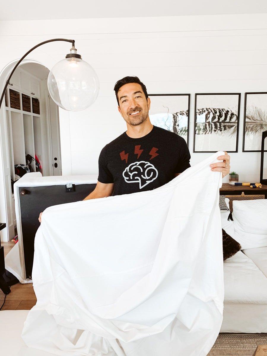 man holding sheet