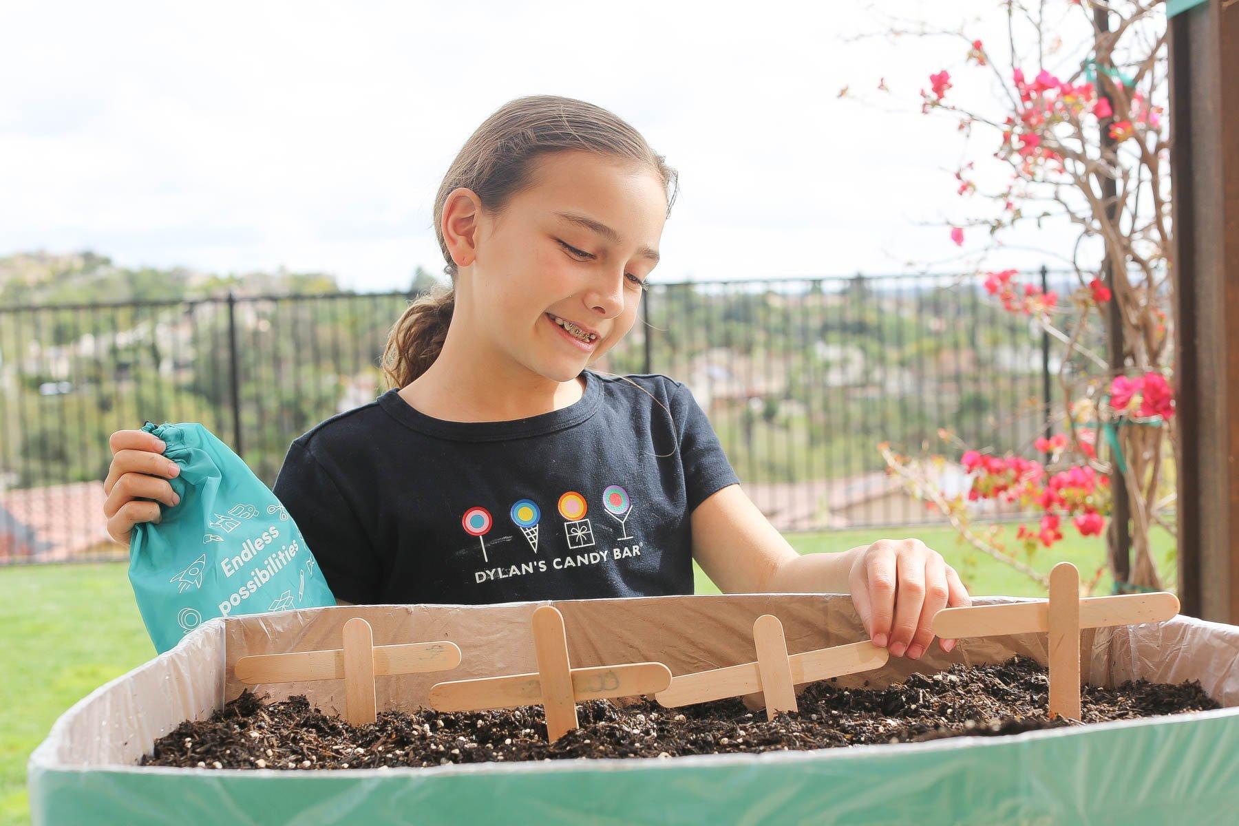 girl making a garden