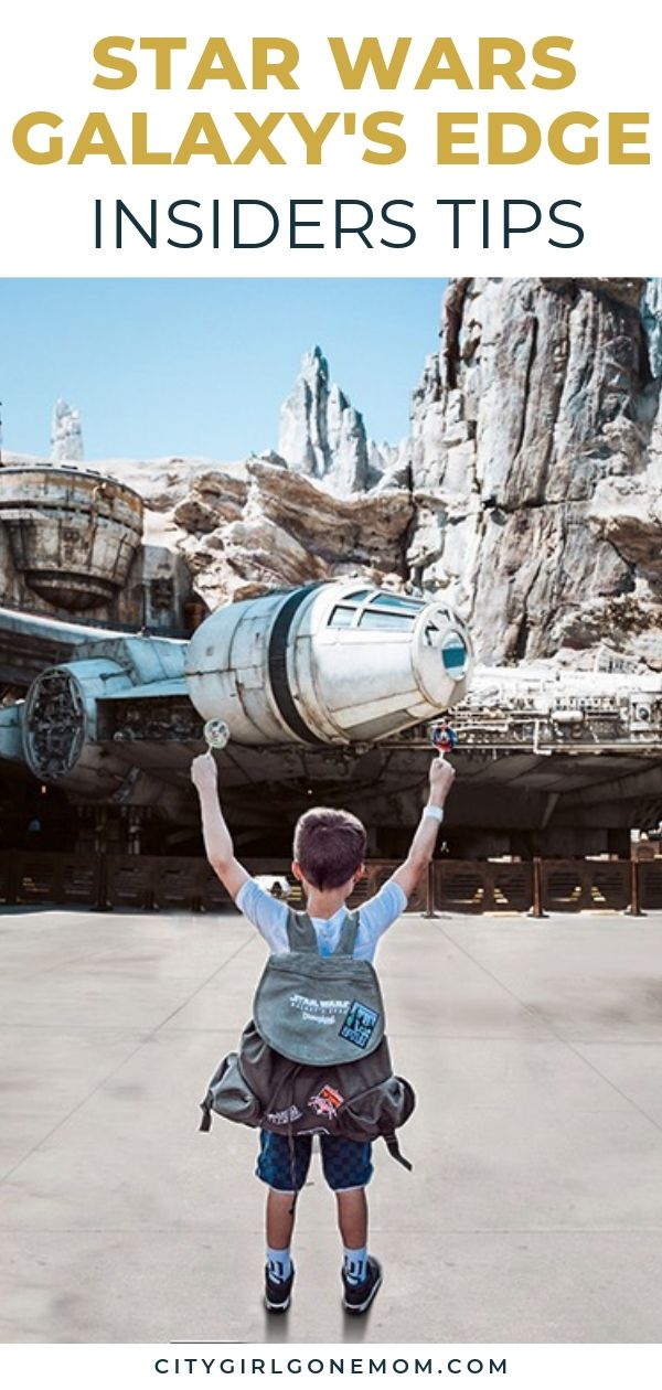 boy in front of millennium falcon