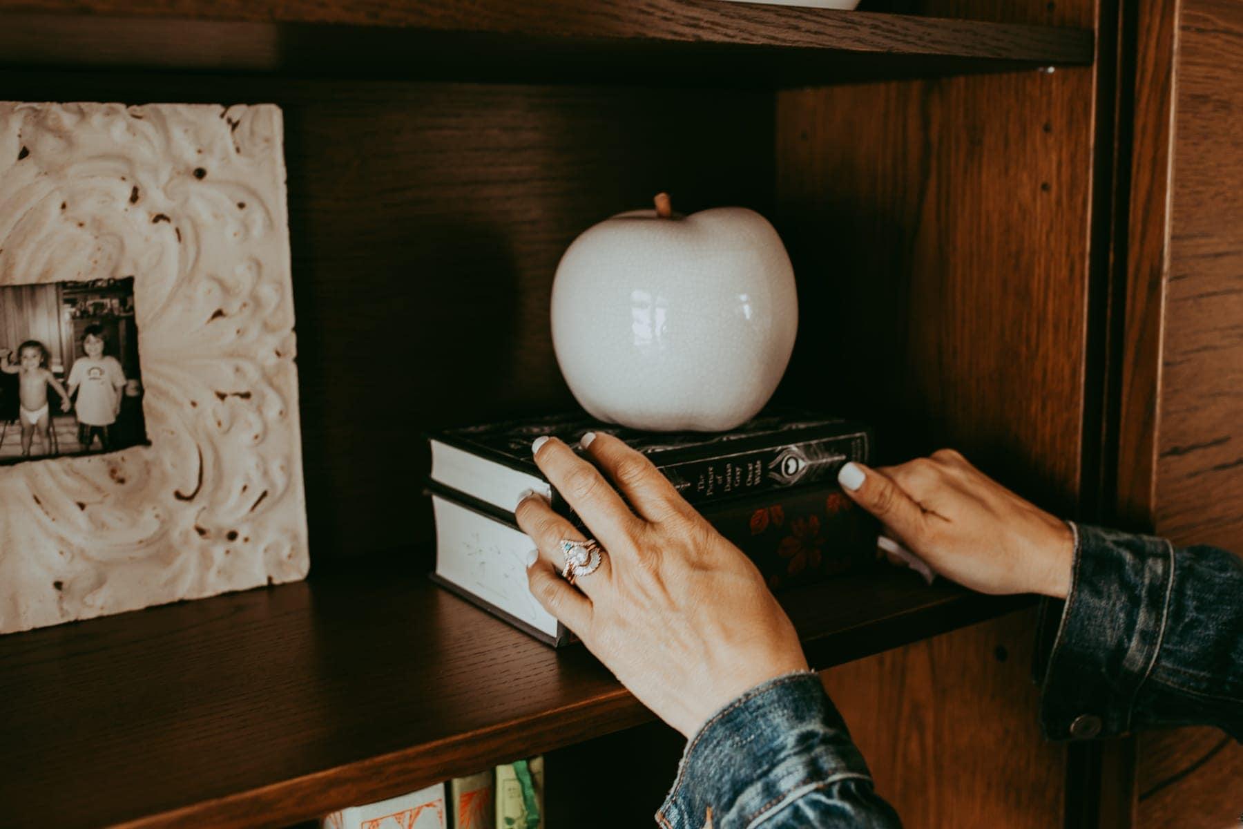 bookshelf hands