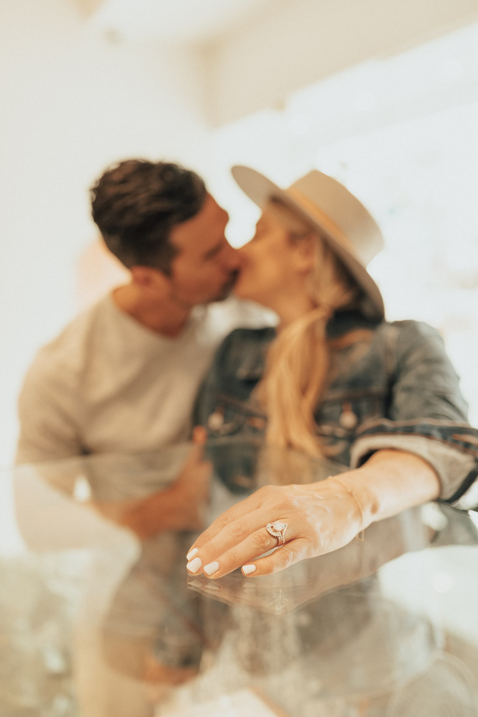 couple kissing with ring