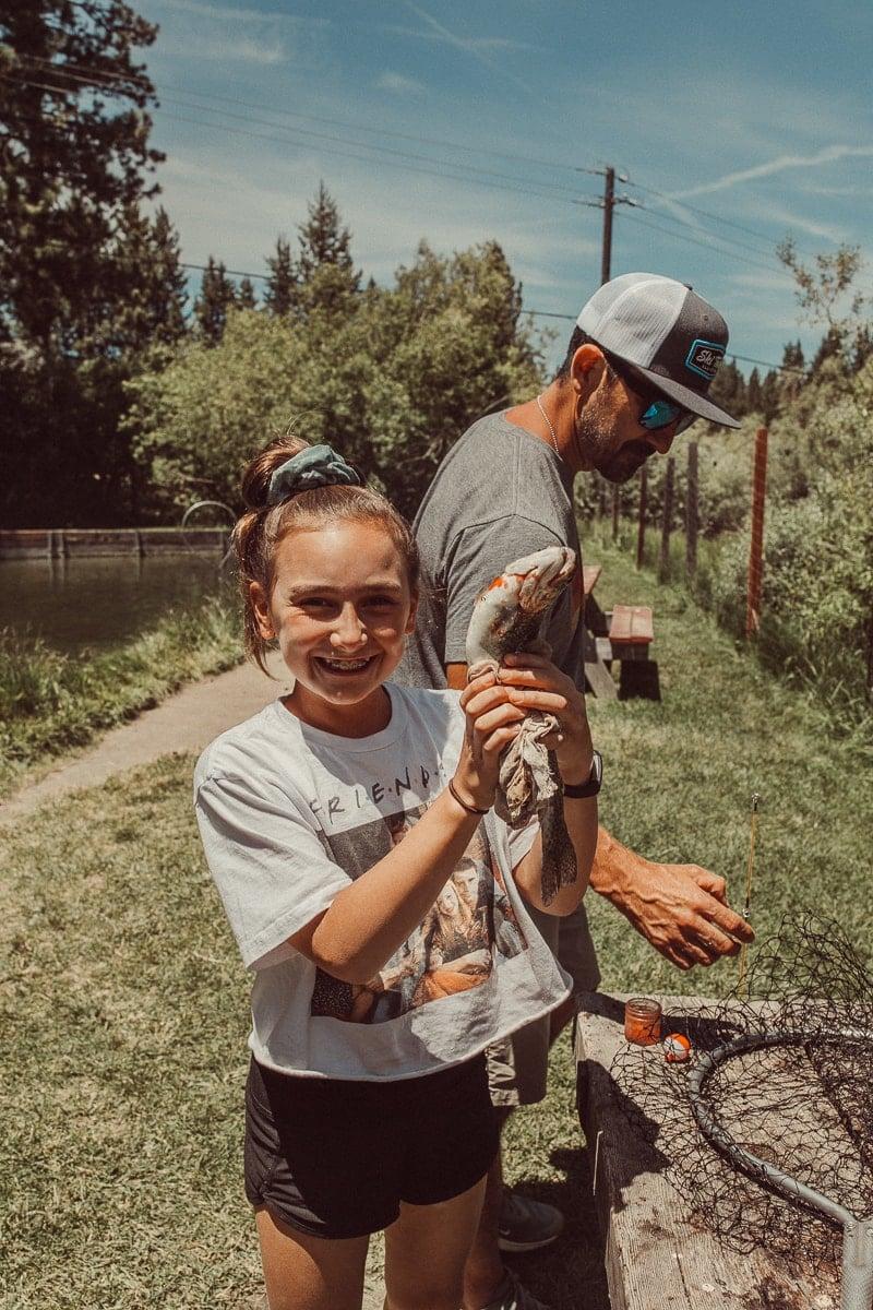 girl catching fish