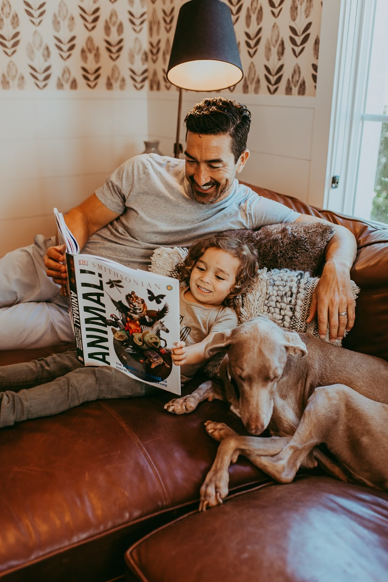 father son dog reading