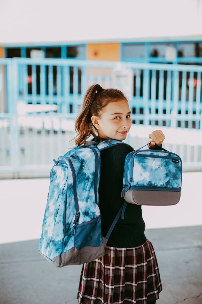 school girl with backpack and lunch