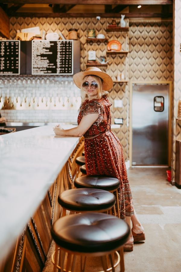 woman standing at bar