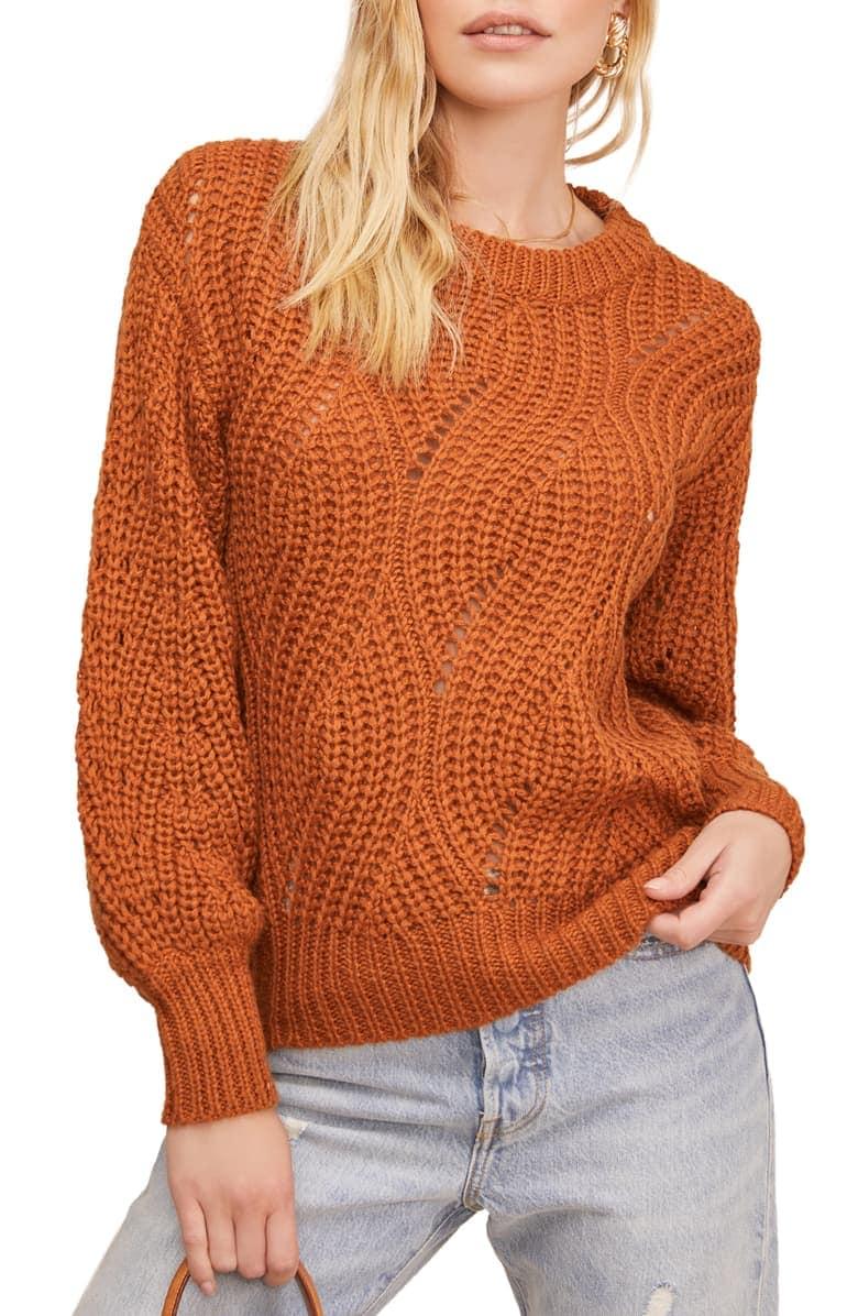 woman in orange sweater