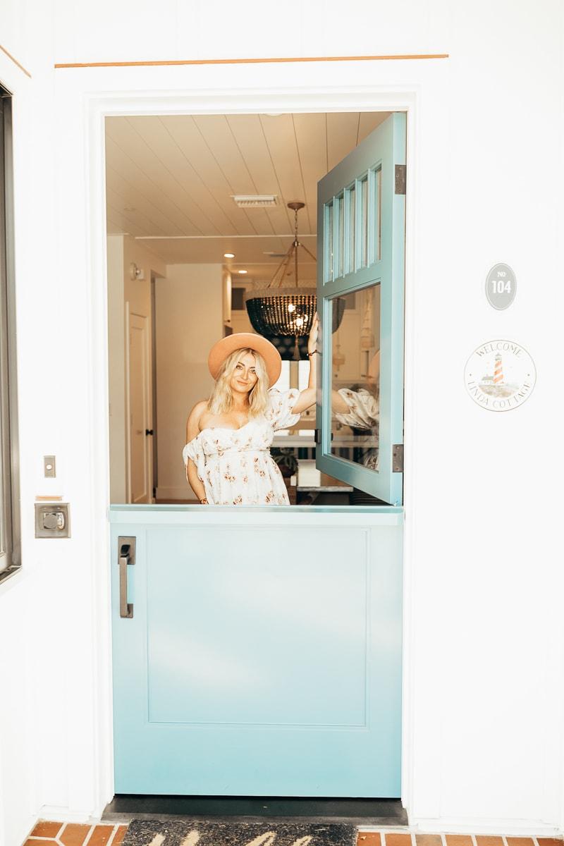 woman posing at door