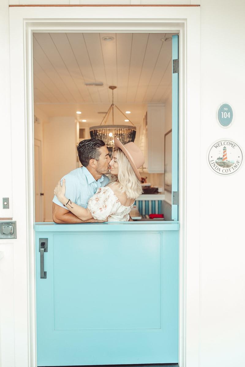 couple kissing in doorway