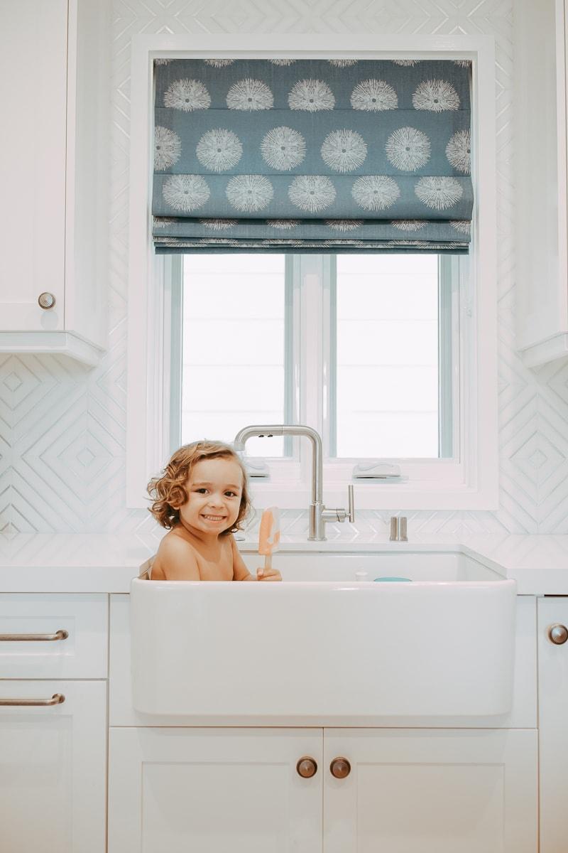 baby in kitchen sink