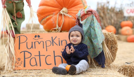 baby in pumpkin patch