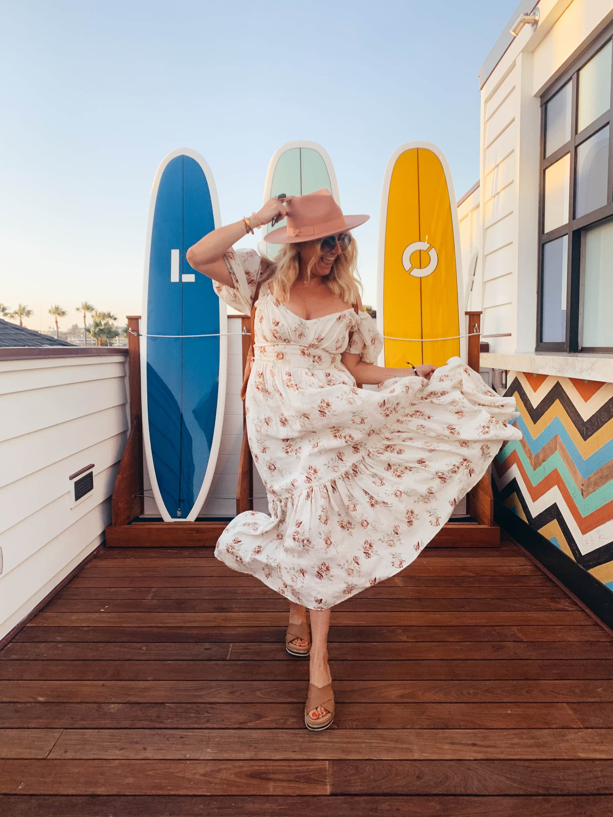 woman with surfboards