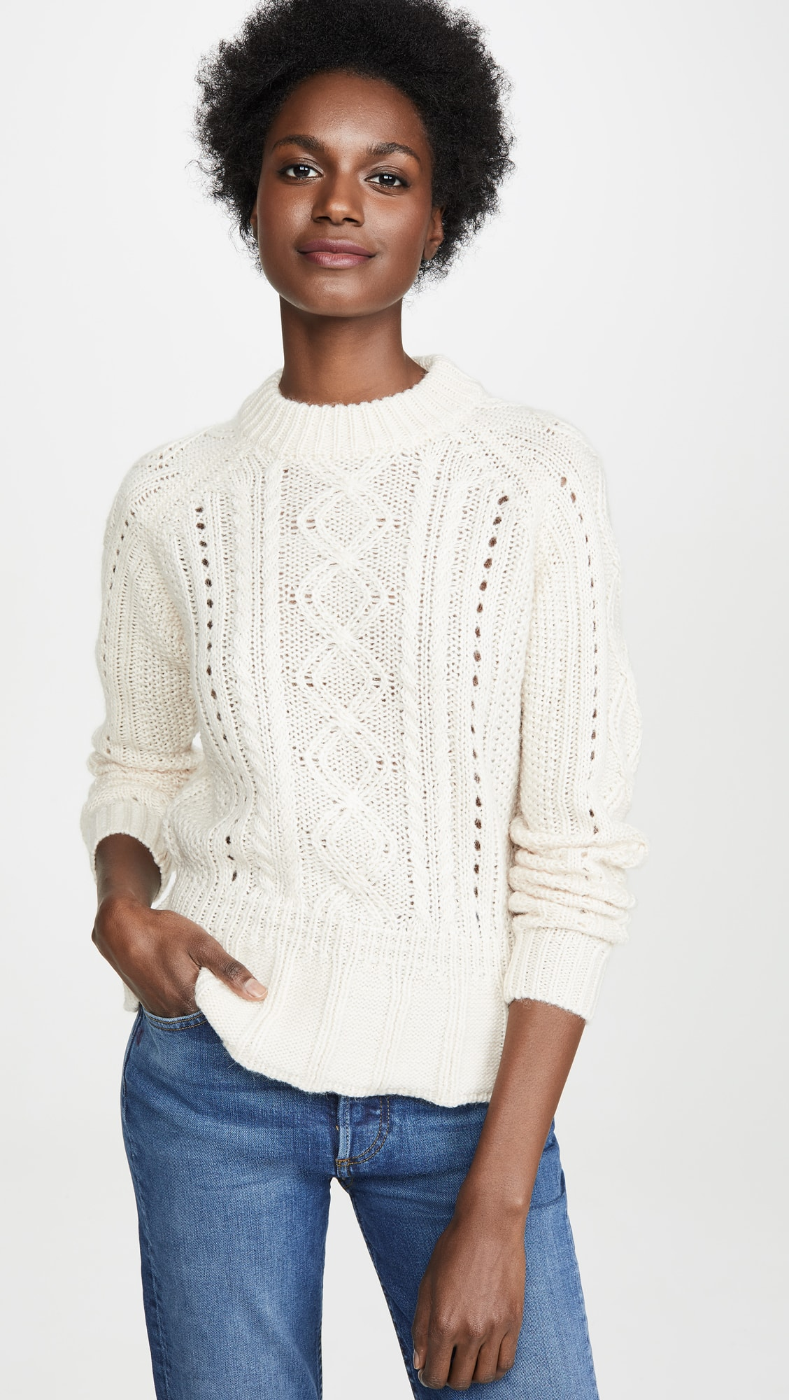woman in white sweater