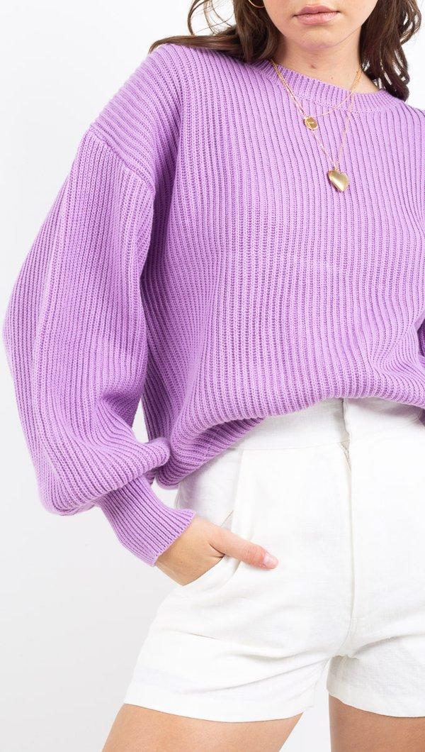 woman in purple sweater