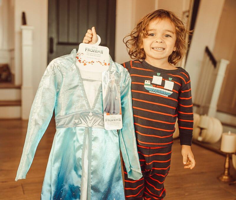 toddler holding princess dress