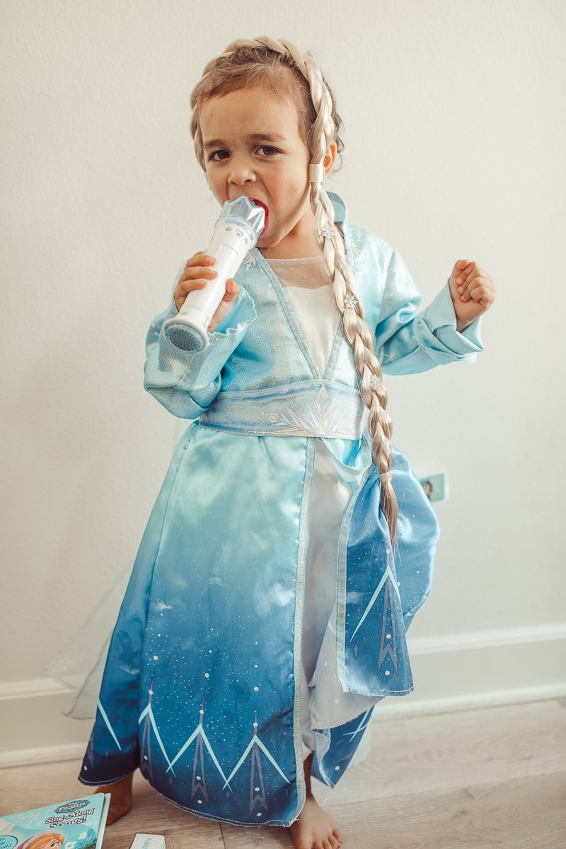 toddler singing in frozen dress