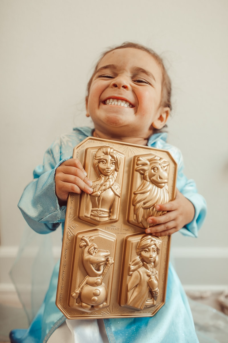 happy toddler with baking pans frozen