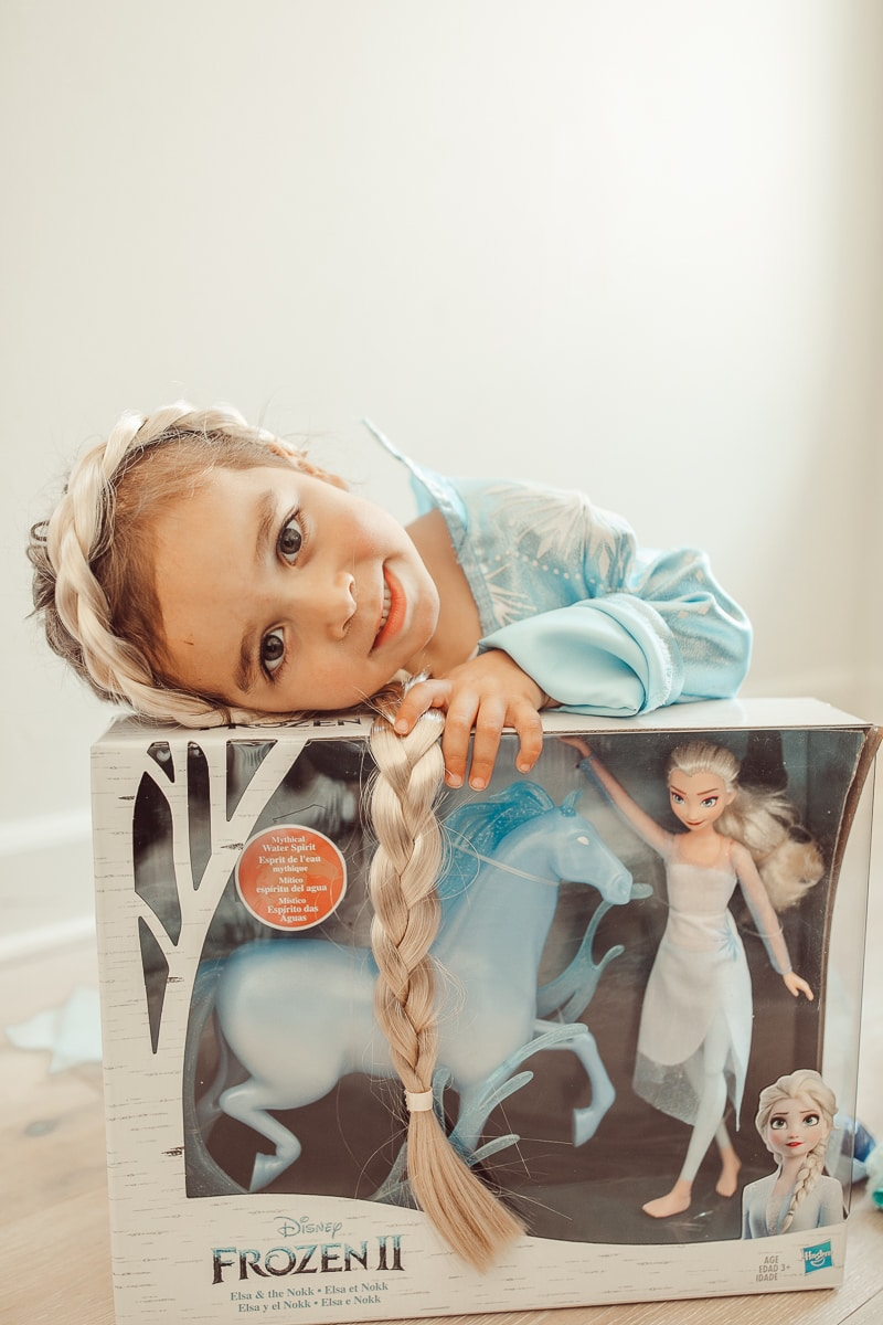 child with disney frozen 2 toy