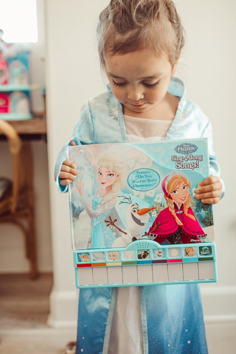 toddler with disney frozen toy