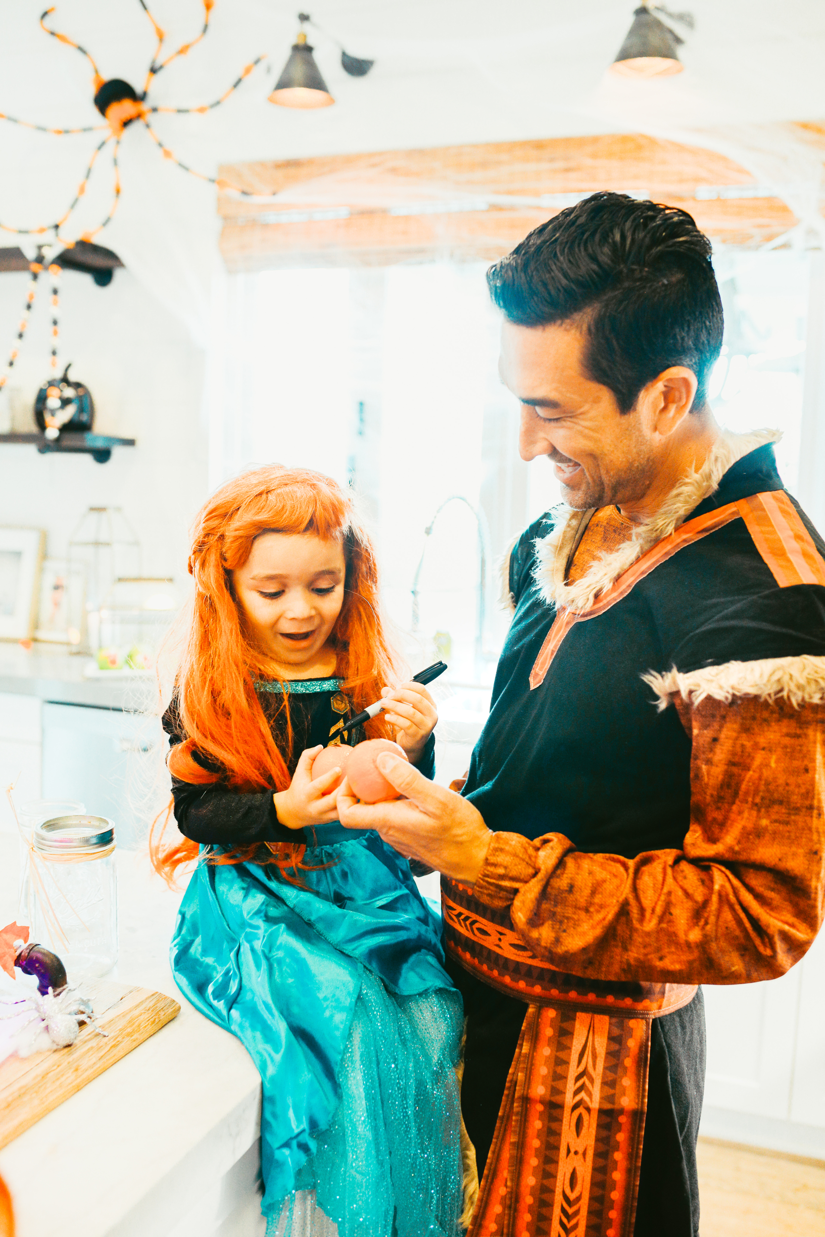 dad and kid dressed up in costumes