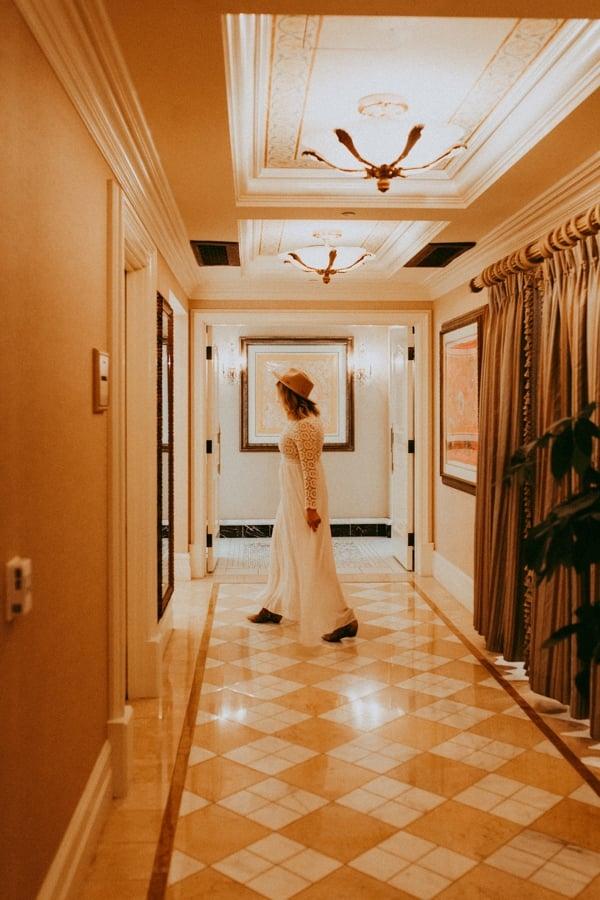 woman walking down hallway