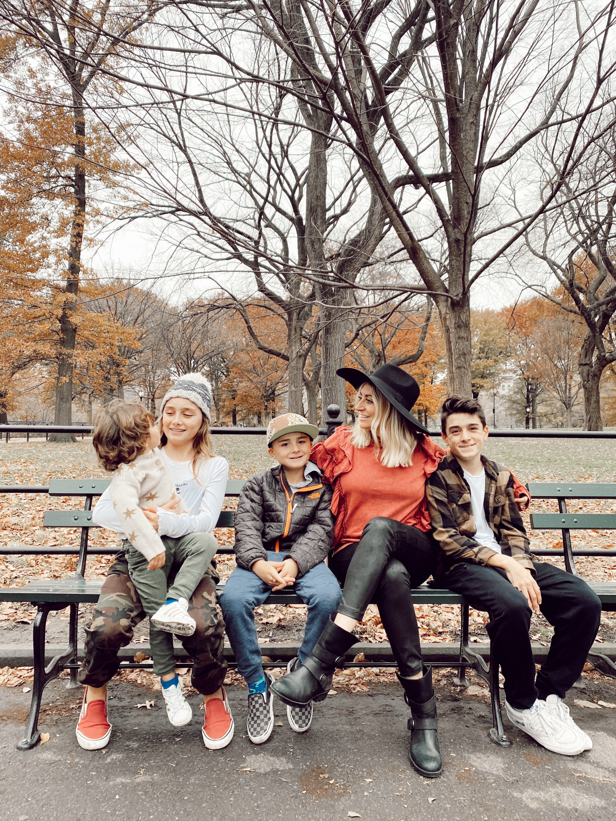 family on park bench