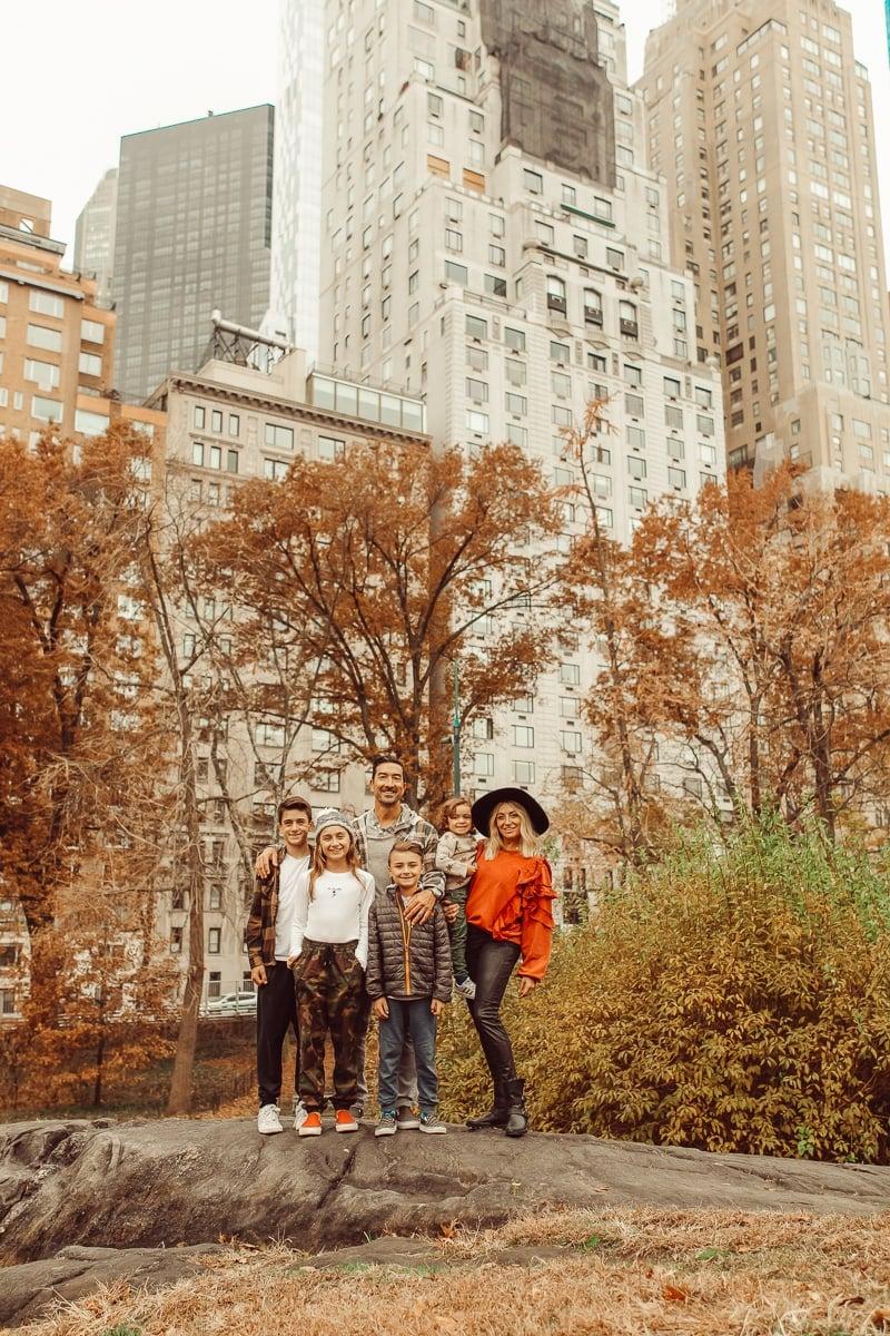 family posing in central park
