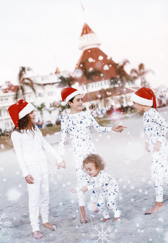 kids in pajamas on the beach