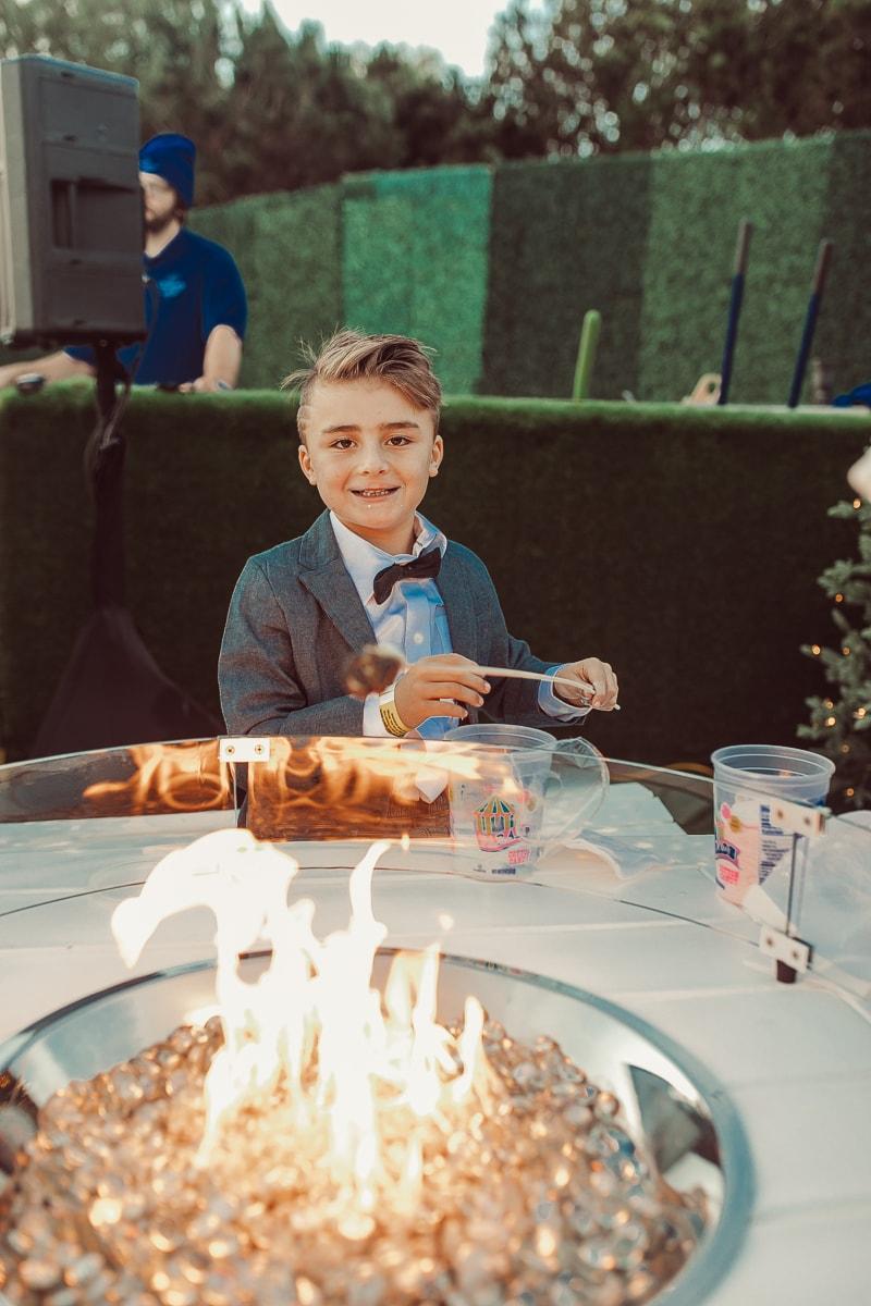 boy roasting marshmallows