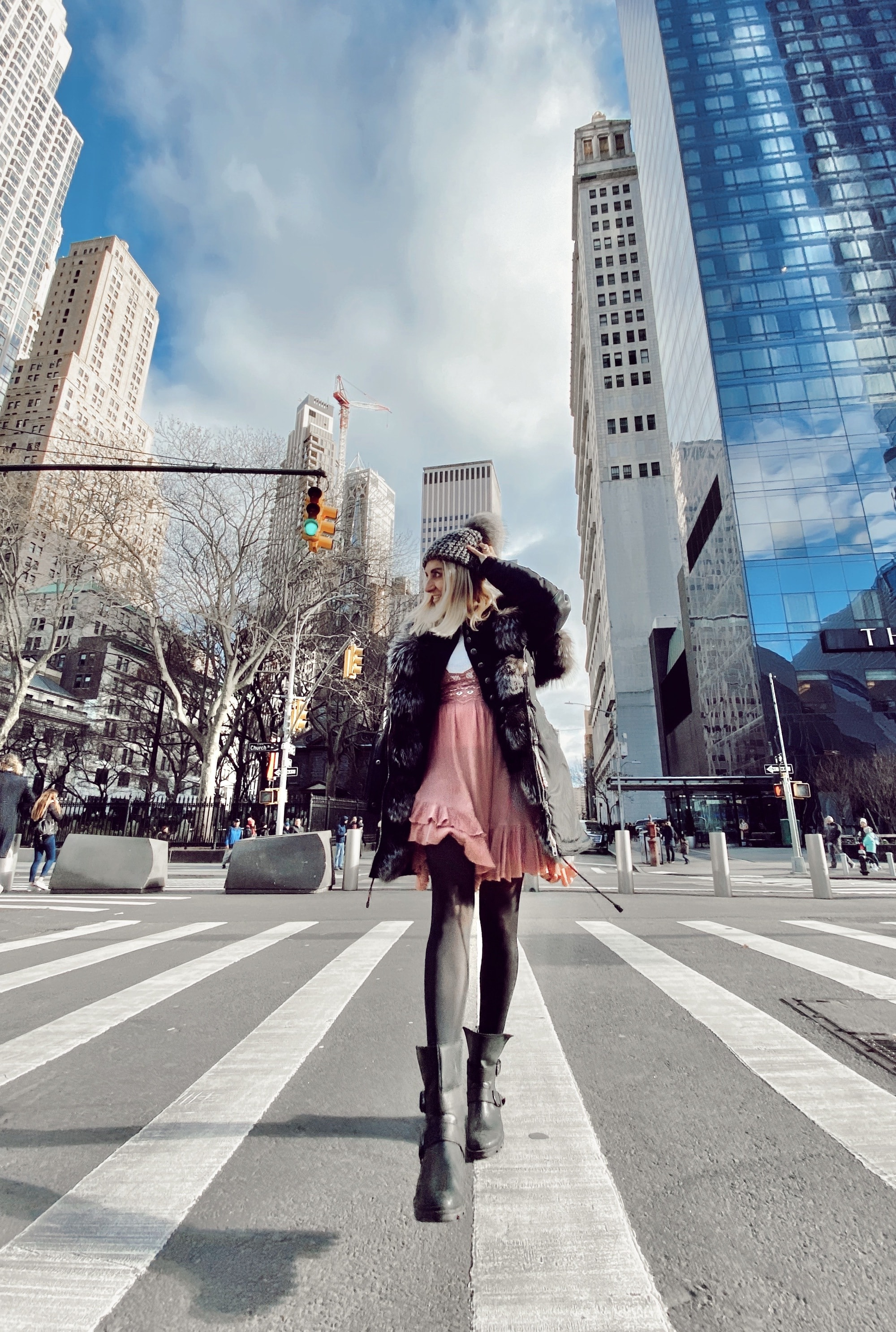 woman crossing the street in new york