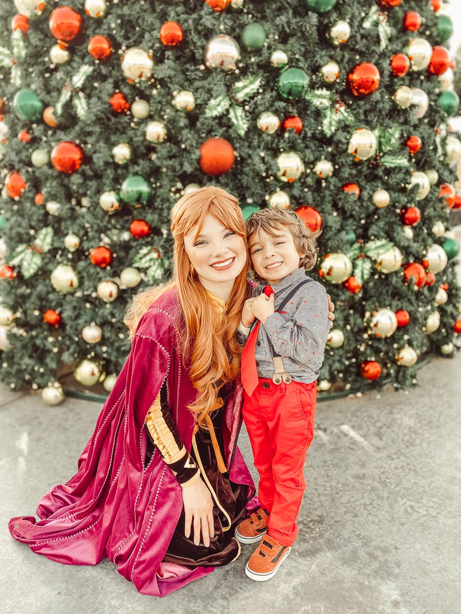 woman and boy by christmas tree