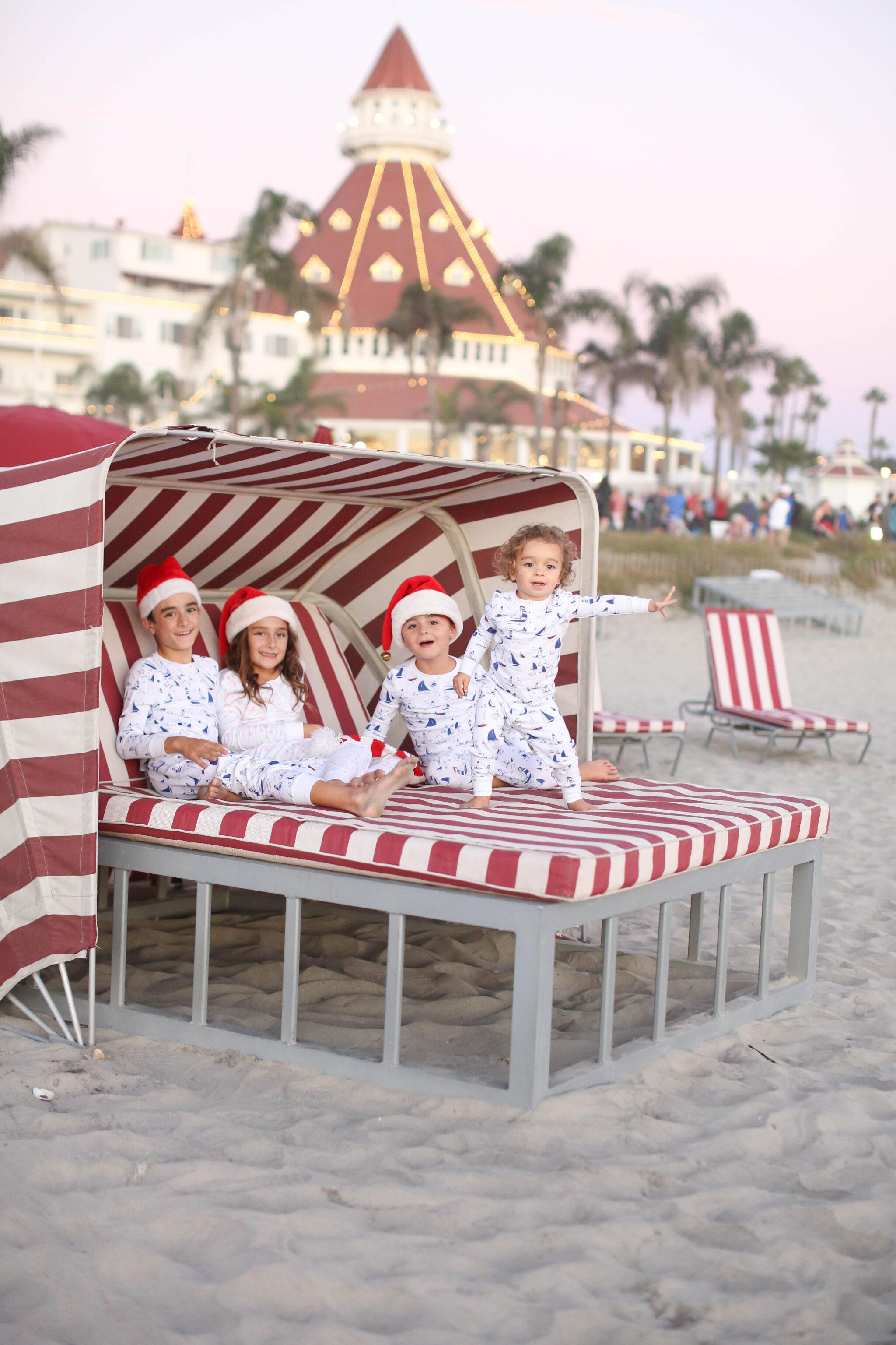 kids in santa hats on the beach