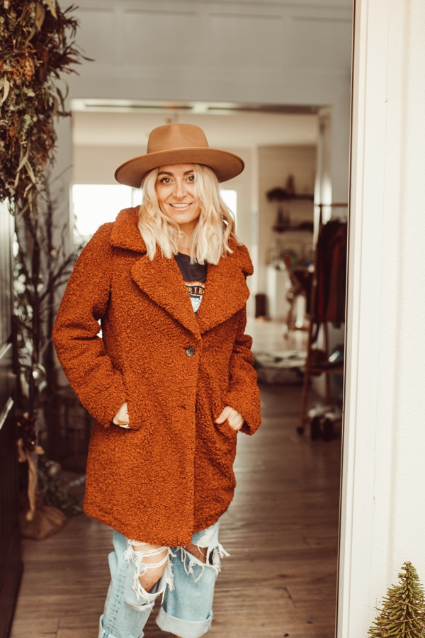 woman posing in coat