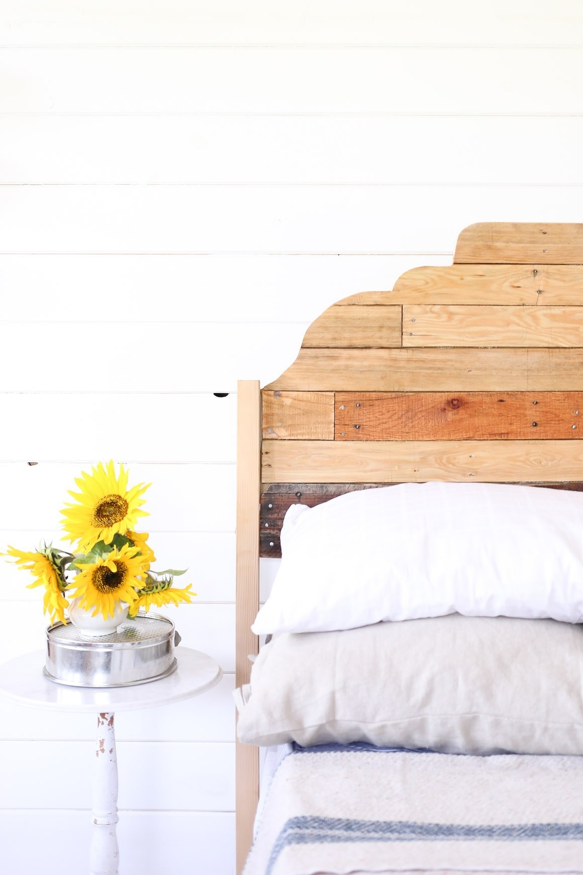 wooden bed with flowers