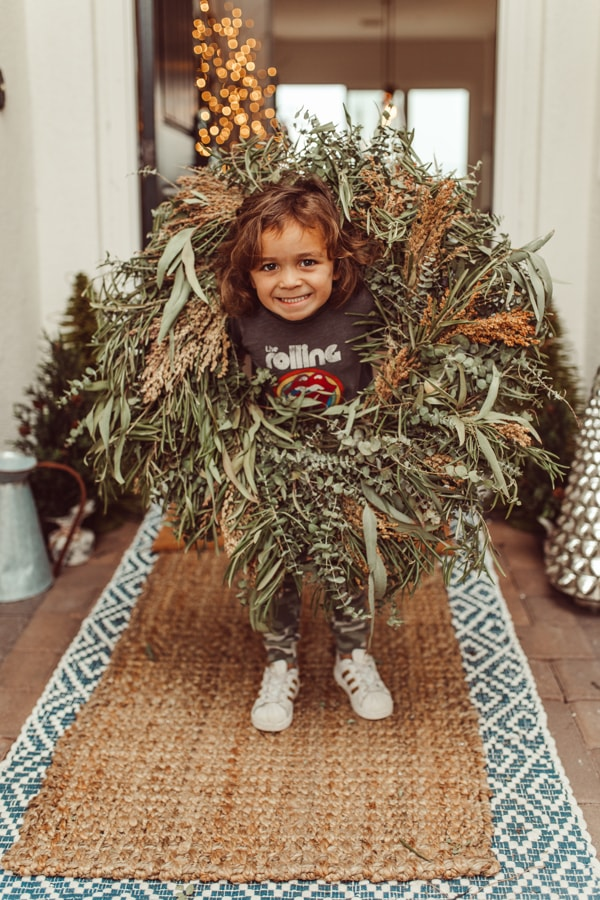 toddler in christmas wreath