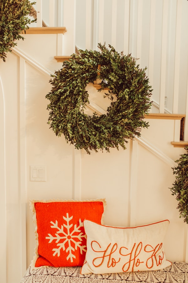 christmas wreaths on staircase