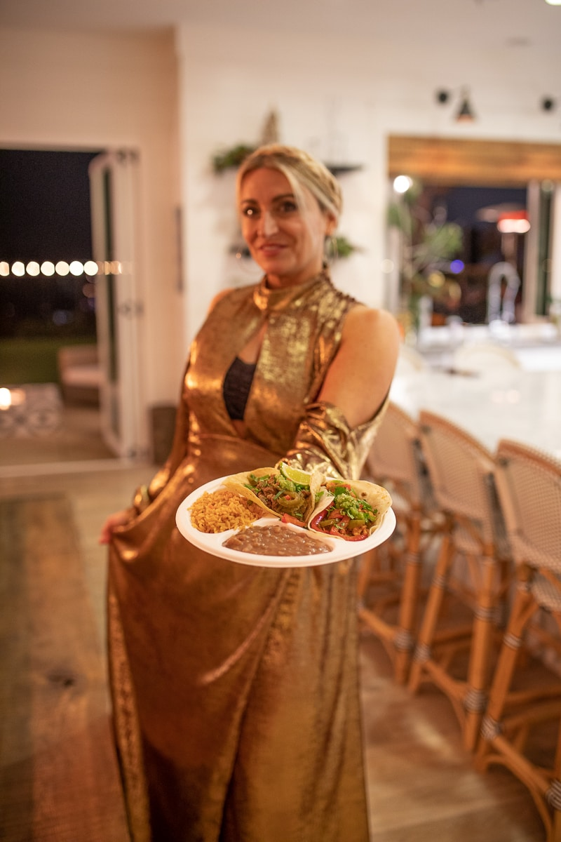 woman holding taco plate