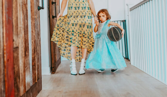 toddler in dress with mom