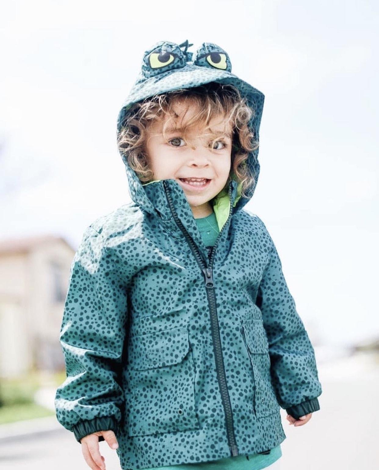 boy in dinosaur jacket