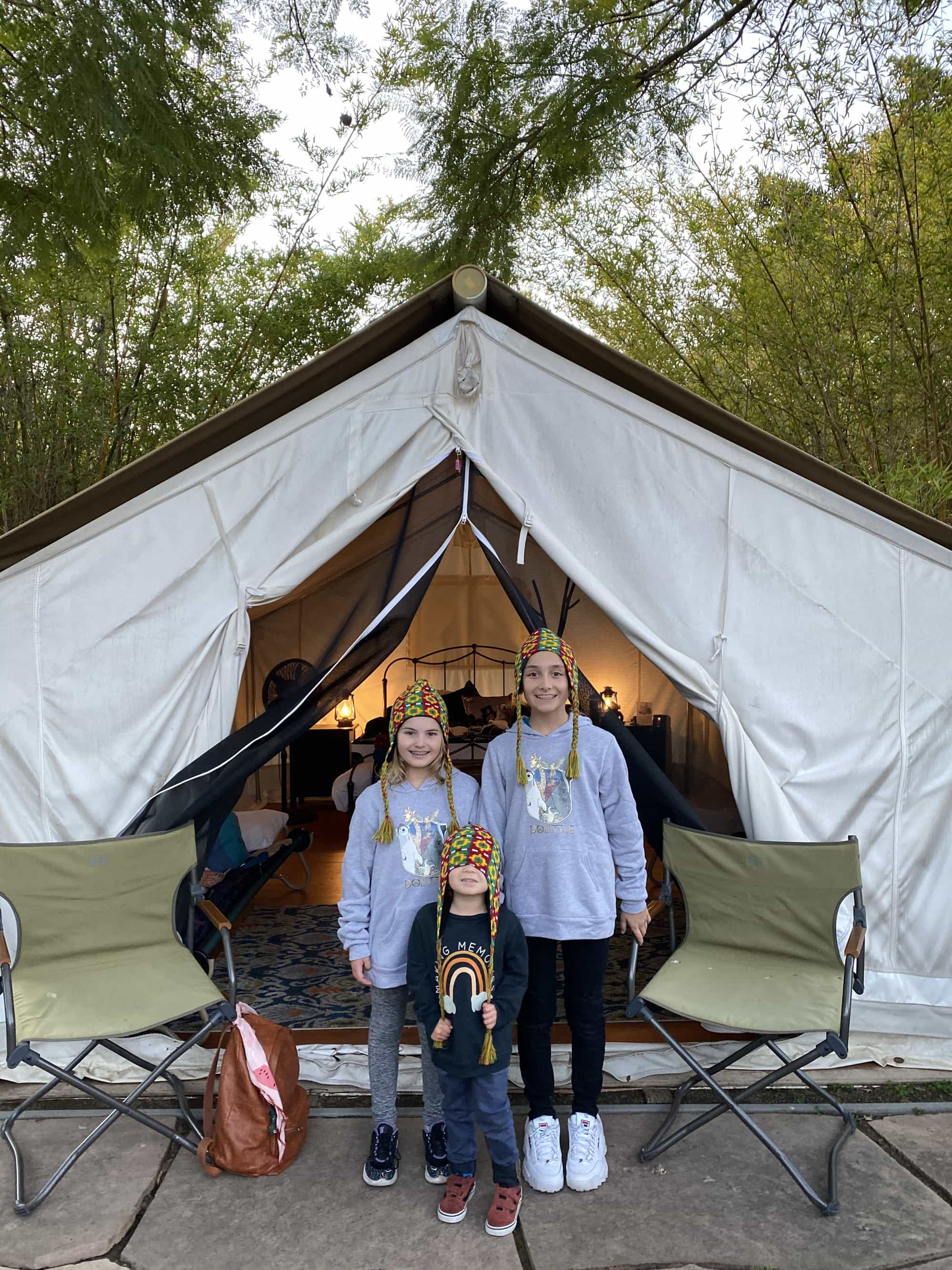 kids standing in front of tent