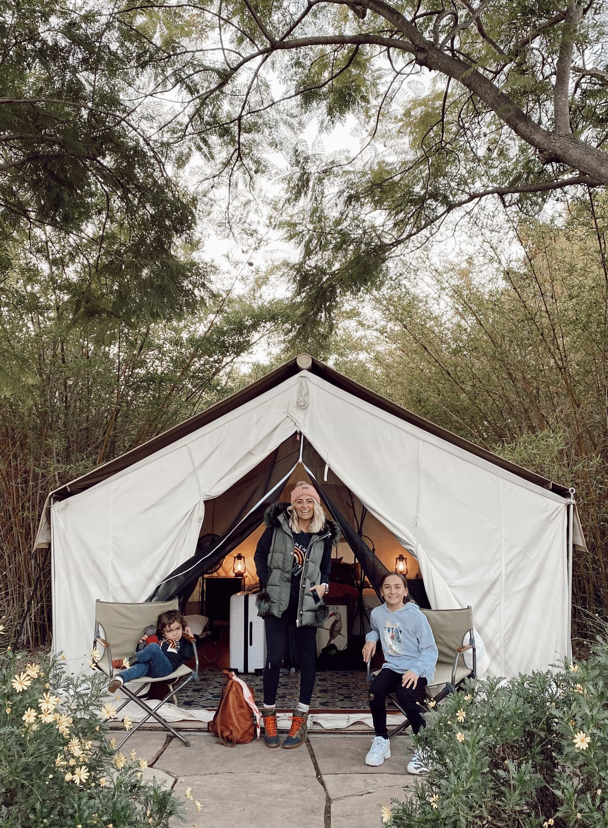 family in front of tent