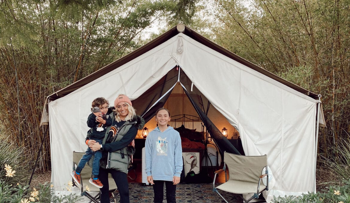 family outside tent