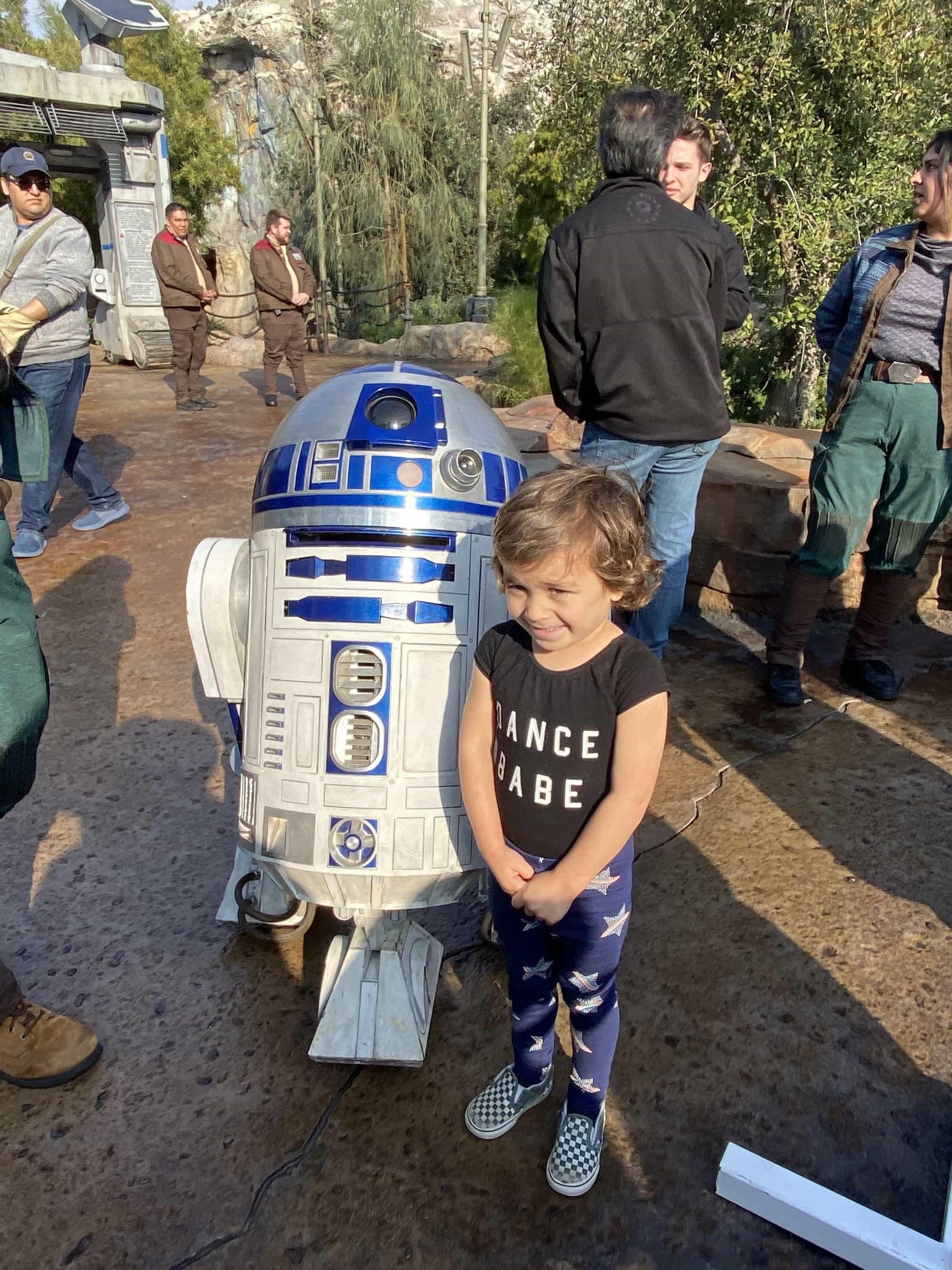 child with r2-d2 star wars